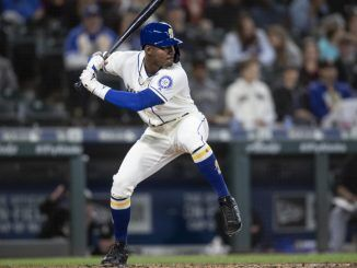 Kyle Lewis takes a swing at the plate.