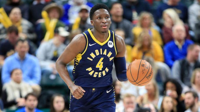 Victor Oladipo dribbles up the court