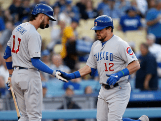 Kyle Schwarber celebrates with Bryant