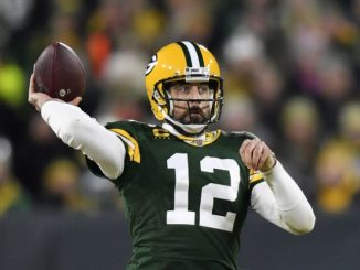 Aaron Rodgers throws ball