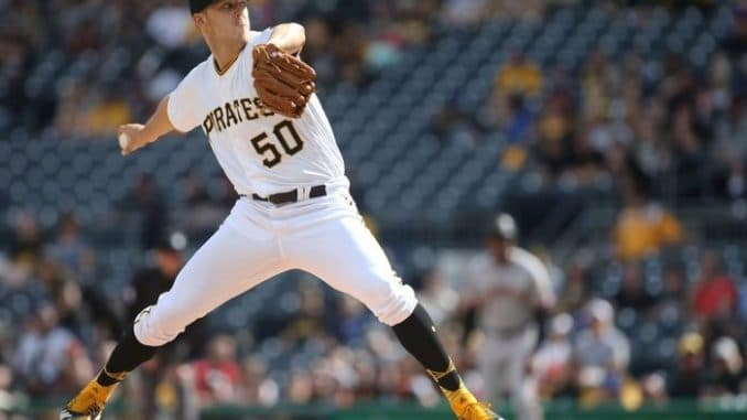 Jameson Taillon throws pitch