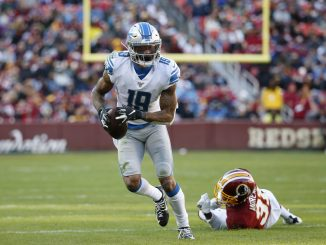 Kenny Golladay carries ball
