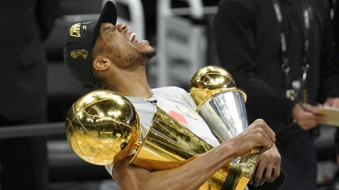 Giannis holds trophies