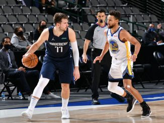 Steph Curry guards Luka Doncic